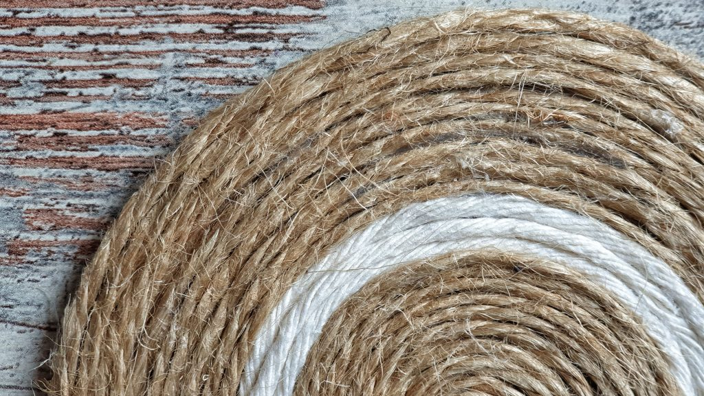 Spiral coaster made of jute twine and white macrame cord