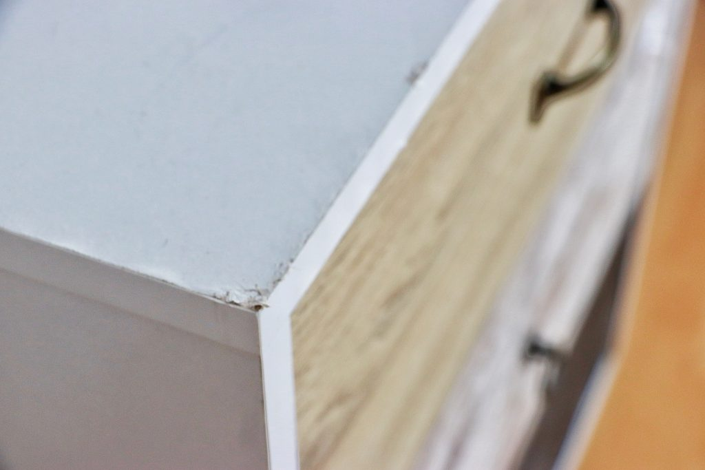 Damaged corner in the chest of drawers