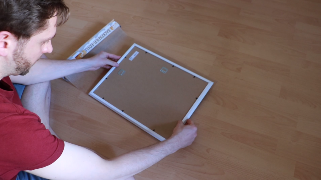 Measuring the picture frame on the baking paper