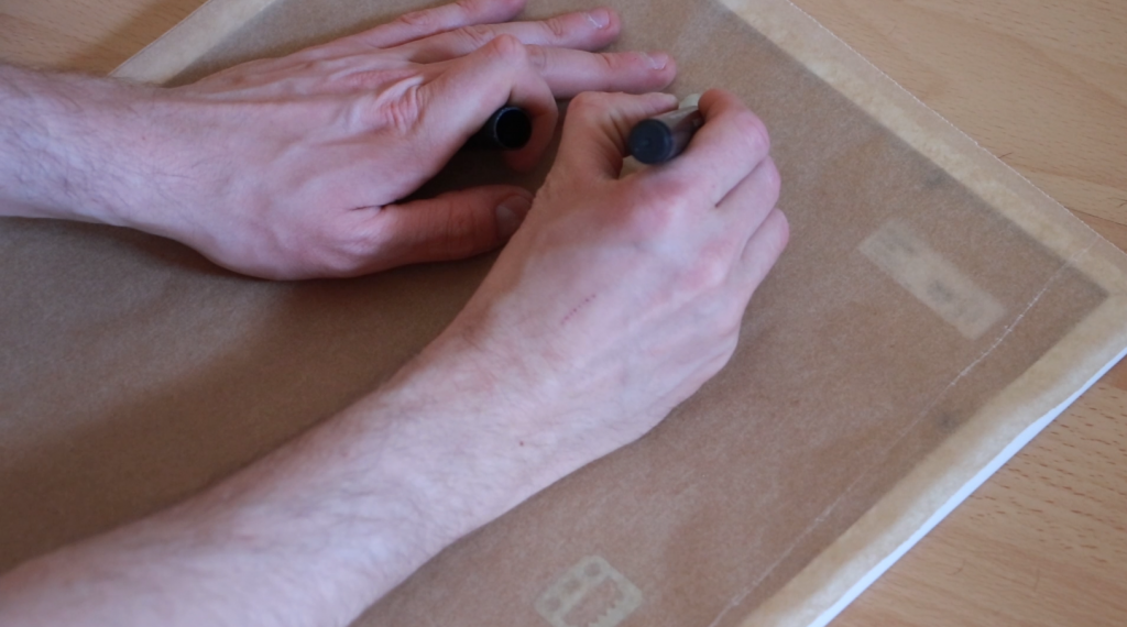 Marking the hole for the nail to hand the picture frame