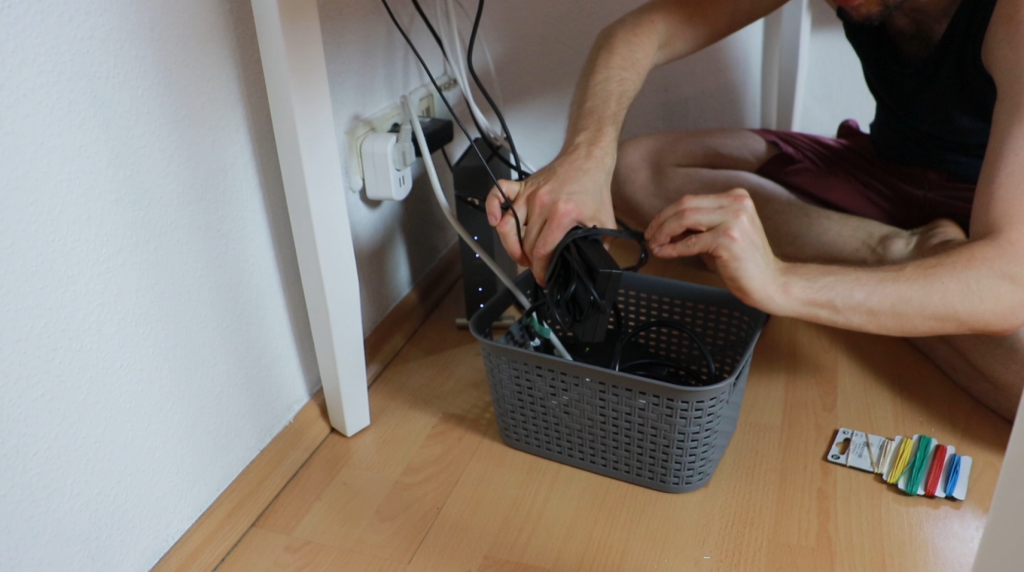 Organizing cables and wires in the basket in home office