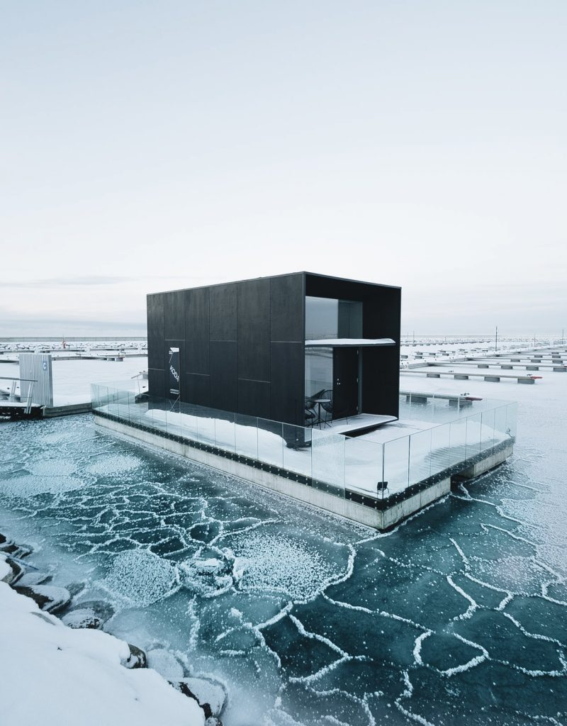 Floating tiny house in icy sea