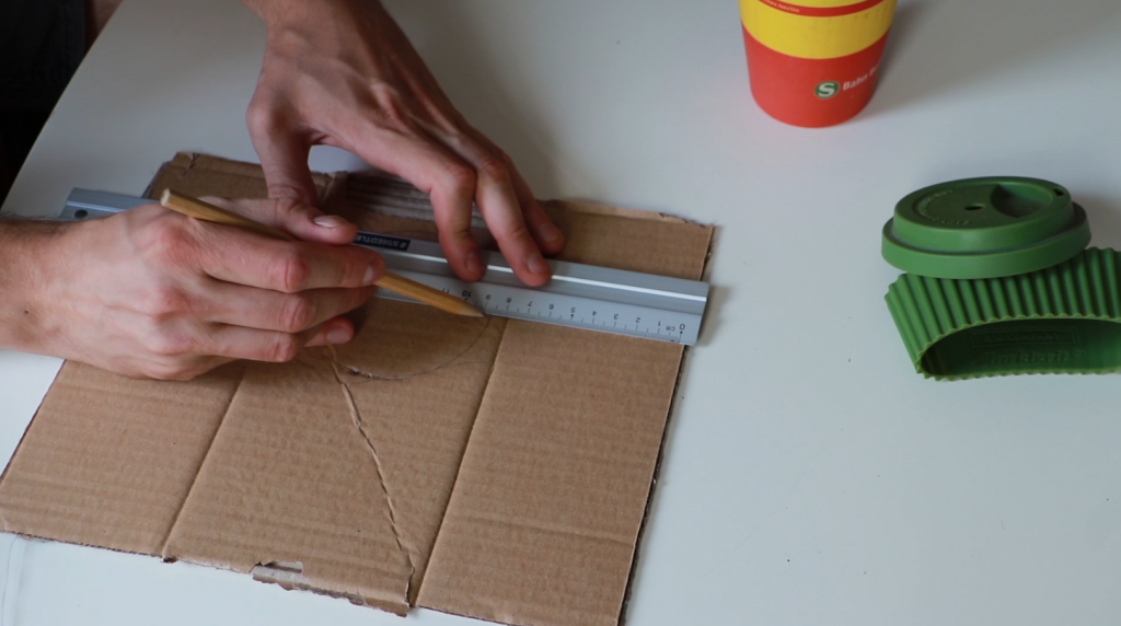 Measuring the cardboard wall for the mould